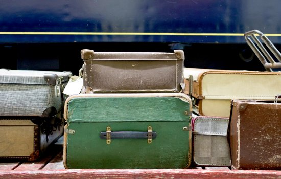 Vintage luggage next to a railway carriage