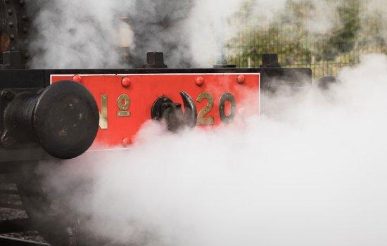 Detail of a locomotive in steam