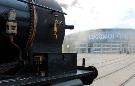A locomotive in front of the Collection Building