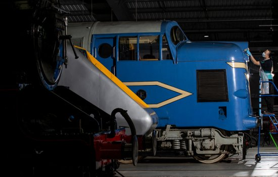 A loco is cleaned in the collection building