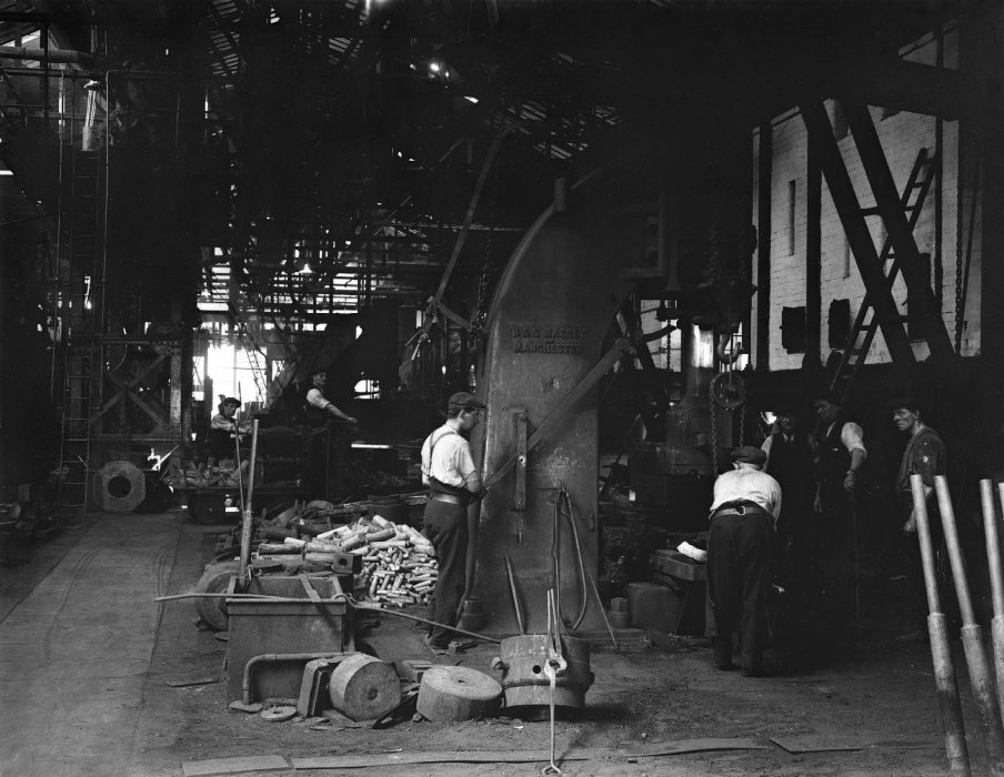 Black-and-white photograph of workers using a drop hammer in the forge at the North Eastern Railway's Shildon works, County Durham, about 1913.