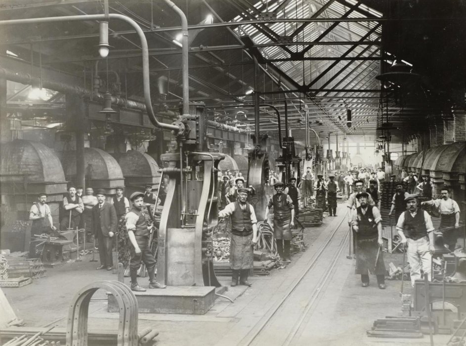 Workers in the forge at the North Eastern Railway's Shildon works, County Durham, about 1910.